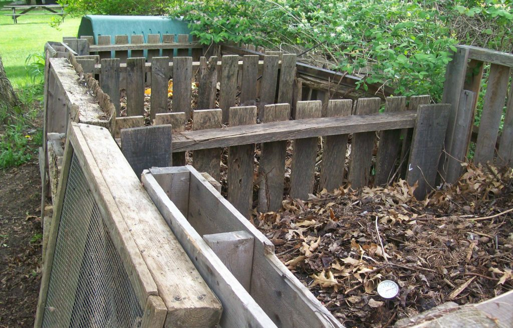 A large backyard compost bin