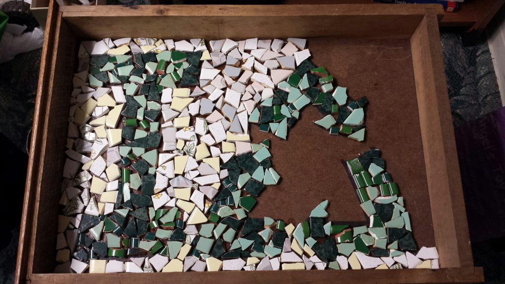 A mosaic that reads I recycle