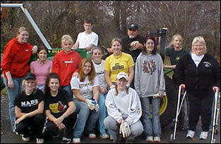 A group of cleanup volunteers posing for a photo