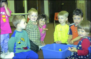 Kids learning about a worm bin