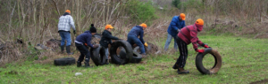 Volunteers doing a tire cleanup