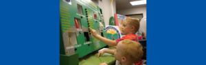 Children using an interactive educational board